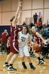 Bishop Noll senior forward Elerna Sobilo takes the ball past Hanover Central sophomore forward Lisa Gac on Thursday.