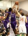 Merrillville's Jamard Owens pulls down a rebound at Valparaiso's basket in the first half Friday.