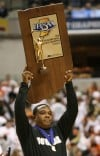 Marvin Rea raises Class A state championship plaque