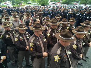Crowds gather for slain officer's funeral