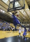 Lake Central's Tyler Wideman dunks in the fourth quarter of Saturday's win at the Class 4A Lafayette Jeff Semistate.