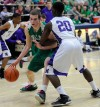 Valparaiso's Quentin Palmer drives against Merrillville's Brian Jenkins on Saturday.