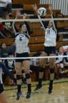 Bishop Noll senior Asya Hobbs, right, and freshman Brittany Anderson combine on a block against Woodlan.
