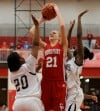 Crown Point's Michaela Prough shoots over Michigan City's Jameka Collins