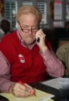 George Van Til works the phones and tallies numbers