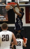 West Side's Ramone Adkins dunks against Lowell on Saturday.