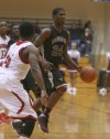 Bowman's Davon Dillard dribbles against E.C. Central on Tuesday night.