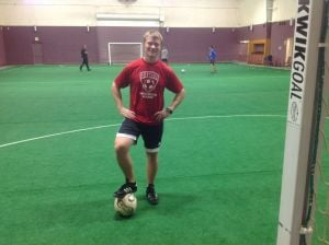 Portage coach directing indoor soccer lessons at Woodland Park