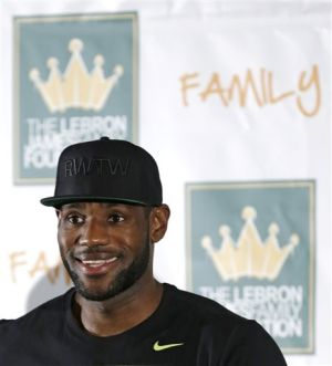 LeBron says he'll stay with Cavs beyond contract
