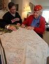 Hobart WWII veteran signs flag