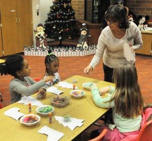 Kids create 'mosaic' Christmas trees at Cal City library