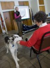 Three-time Iditarod musher, dog, visit students