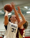 Bishop Noll's Elena Sobilo takes an elbow to the face from River Forest's Amber Ondo during GSSC tourney championship.