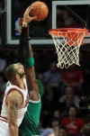 Bulls rally late without Rose to bump off Boston