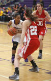 Crown Point's Katija Tarailo and Abby Kvachkoff defend against Hobart's Dajah Hill on Friday night.