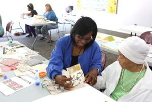 Lansing library class creates beauty from scraps of paper