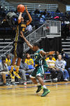 Roosevelt's LaDontaz Tolbert shoots a 3-pointer Saturday against Indianapolis Crispus Attucks.