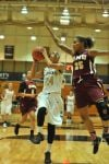 Purdue Calumet's Tiera Turner drives the lane against Robert Morris' Tikeyiah Johnson on Wednesday in the CCAC tournament quarterfinals.