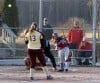 Frigid temps have area softball teams begging for some sunshine