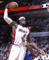 James' triple-double lifts Heat to NBA title