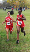 T.F. South cross country runners Fritzi Flores, left, and Nia Bell,