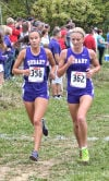 Hobart girls cross country runners Celena Guerrero and Mindy Whidden