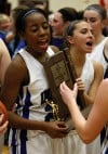 Lake Central's Rolanda Curington, left, and Chrissy Addison carry the Class 4A Munster Sectional trophy off the floor Saturday night.