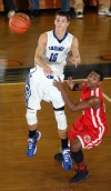 Lake Central's Mike Miklusak passes the ball as Morton's Devon Mingo applies defensive pressure Friday.