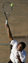 Munster's Trey DeLuna serves against Merrillville's Ayron Williams during Wednesday's Munster Regional championship.