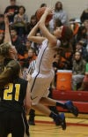 South Central's Hannah Stotle tries an off-balance shot against Kouts in Saturday's PCC title game.