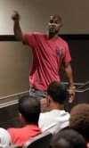 Antwaan Randle El addresses players during a football training camp