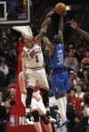 Rose scores 26 points as Bulls beat Mavs