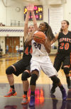 Merrillville's Jaz Talley gets some opposition from LaPorte's Kate Ulmer on a shot attempt Friday.
