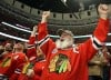 Blackhawks fans celebrate a goal by Michael Frolik