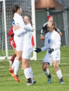 Lake Central's Madison Berumen is congratulated by teammate Abigail Peppin