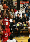 Portage's Tim Bryant shoots against Griffith on Friday night.