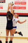 South Central's Briana Satoski, left, goes up for the block attempt against Boone Grove's Kennedy Starcevich during Thursday night's PCC tournament.