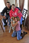 Indiana family reunites with dog month after tornado