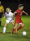 Lowell's Morgan Stokes, left, and Crown Point's Jenna Arnold fight for possession during Thursday's Class 2A Crown Point Sectional.