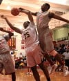 Thornwood senior Khapri Alston is fouled by T.F. South senior Kaleb Garret