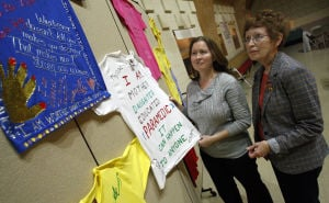 Survivors share stories of domestic abuse at St. Jude House vigil