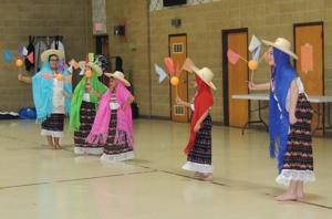 Folk dancers celebrate feast day at churches