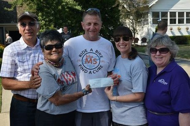 Friends and neighbors raise funds for local bike team