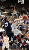 Crown Point's Thomas Bardeson shoots around Michigan City's Ryan Taylor on Thursday night.