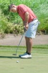 Crown Point's Mike Lee holes a putt