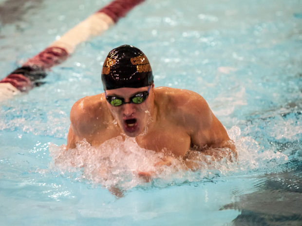 Chesterton boys swimmers roll to 19th straight DAC meet title