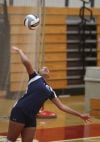 E.C. Central's Nautica Watson serves to West Side on Thursday night.