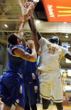 Valparaiso's Moussa Gueye battles for a rebound with Saint Louis' Grandy Glaze during the first half Saturday.