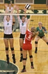 Valparaiso's Anne Clark and Kaitlyn Bontrager block Crown Point's Alyssa Kvarta