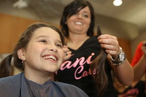 Girl donates locks to benefit Porter County Cancer Society